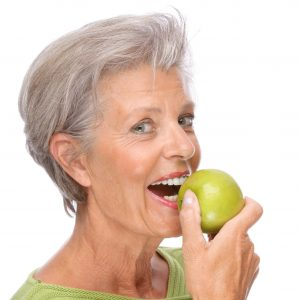 woman preparing to eat apple