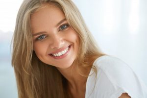 woman blonde hair beautiful teeth