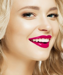Woman with a beautiful smile thanks to teeth whitening in flint mi